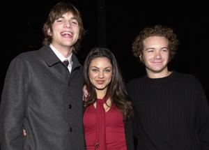 """Ashton Kutcher, Mila Kunis, and Danny Masterson arrive at the premiere of USA Films'' """"Traffic"""" December 14, 2000 at the Academy of Motion Pictures Arts and Sciences Theatre in Beverly Hills, CA. (Photo by Chris Weeks/Liaison)"""