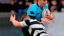Harry Byrne of St Michael's is tackled by Belvedere's Tom de Jongh Photo: Sportsfile