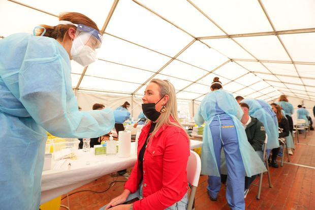 Sarah Dungan has a Covid antigen test taken by tester Aoife Roche before attending the Pilot music Festival in the Royal Hospital  . Picture; Gerry Mooney