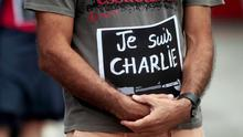 A French man residing in Nicaragua holds up a card that reads, 'I am Charlie', to pay tribute to the victims of the shootings in France at the offices of the satirical weekly newspaper Charlie Hebdo and a Jewish deli, in Managua. Reuters