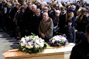 People attend the funeral ceremony of Stephane Charbonnier also known as Charb, the publishing director of Charlie Hebdo, in Pontoise, outside Paris (AP Photo/Martin Bureau)