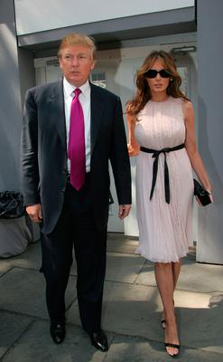 Donald Trump and his wife Melania Trump attends day 4 of Olympus Fashion Week Spring 2006 at Bryant Park September 12, 2005 in New York City. (Photo by Astrid Stawiarz/Getty Images)