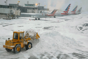 File Pic: A bulldozer clears the airplane gate areas of snow at LaGuardia Airport in New York last winter. REUTERS/Shannon Stapleton.