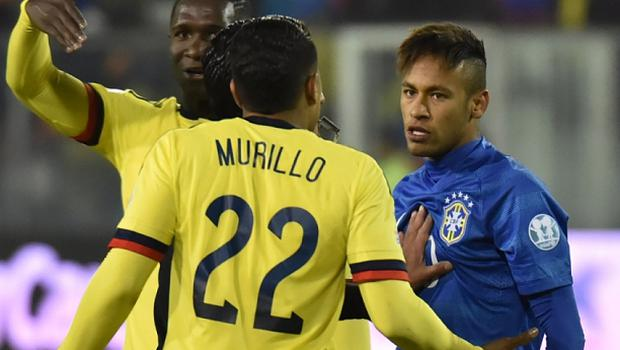 Brazil's forward Neymar argues  with Colombians Jeison Murillo (22) and Alexander Mejia (15) among others during a  2015 Copa America football championship match in Santiago, Chile