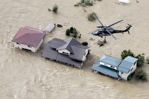 An aerial view shows a Japan Self-Defence Force helicopter flying over residential areas flooded by the Chikuma river following Typhoon Hagibis in Nagano, central Japan, October 13, 2019, in this photo taken by Kyodo. Mandatory credit Kyodo/via REUTERS