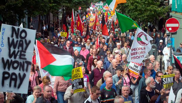 Demonstrators march along Parliament Street during an anti-water charges protest in Dublin in September 2016 Photo: Tony Gavin