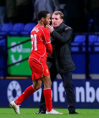 Raheem Sterling, who has been in the eye of a storm this week following the revelation that he wants to leave Liverpool, shakes hands with manager Brendan Rodgers on Thursday (Peter Byrne/PA Wire)