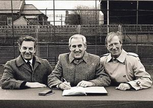 Michael Hyland, president of the FAI, Arnold O'Byrne and Jack Charlton inking a sponsorship deal in 1989