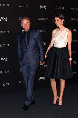 Actor Don Johnson (L) and Kelley Phleger attend the 2014 LACMA Art + Film Gala honoring Barbara Kruger and Quentin Tarantino presented by Gucci at LACMA