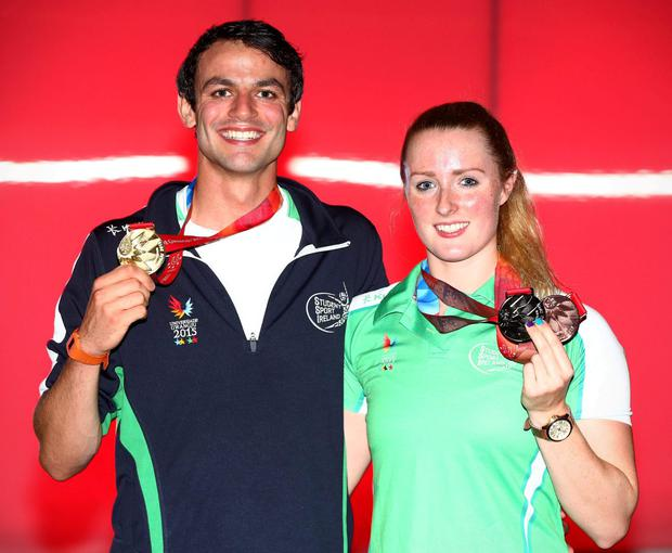 Barr and silver medal swimmer Fiona Doyle show off their silverware INPHO