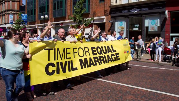 Campaigners attend a rally in Belfast to show their support for marriage equality. PRESS ASSOCIATION Photo. Picture date: Saturday June 13, 2015. Thousands of people walked through Belfast today in a rally for gay marriage rights. Following the Yes vote in last month's Irish referendum, Northern Ireland is now set to be the only part of the UK or Ireland where civil marriage is denied to gay couples, campaigners said. Actress Nuala McKeever is expected to address protesters. Unionists earlier this year rejected a proposal from Stormont Deputy First Minister Martin McGuinness to hold a referendum on the issue similar to the Republic. The Northern Ireland Assembly has rejected a proposal calling for the introduction of gay marriage, after debating the issue for a fourth time. Sinn Fein said equality rights for same-sex couples must be shared by citizens in the north and it will continue to campaign for the reform. See PA story ULSTER Marriage. Photo credit should read: Liam McBurney/PA Wire