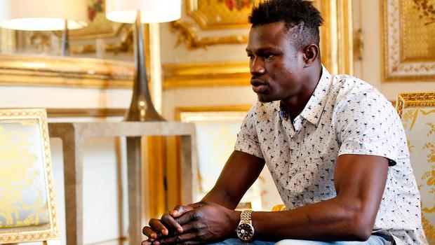 Mamoudou Gassama, 22, from Mali, is pictured during a meeting with French President Emmanuel Macron at the Elysee Palace in Paris, France, May 28, 2018. Thibault Camus/Pool via Reuters