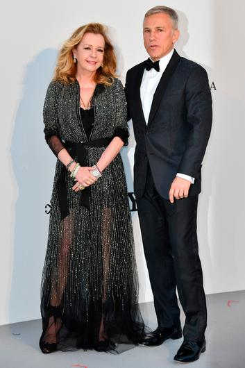 Co-President of Chopard Caroline Scheufele (L) and Austrian actor Christoph Waltz arrive on May 23, 2019 at the amfAR 26th Annual Cinema Against AIDS gala at the Hotel du Cap-Eden-Roc in Cap d'Antibes, southern France, on the sidelines of the 72nd Cannes Film Festival. (Photo by Alberto PIZZOLI / AFP)ALBERTO PIZZOLI/AFP/Getty Images