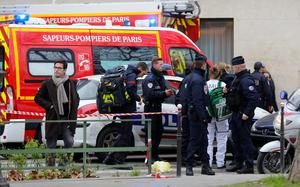 A view shows policemen and rescue members at the scene after a shooting at the Paris offices of Charlie Hebdo, a satirical newspaper, January 7, 2015. REUTERS/Jacky Naegelen