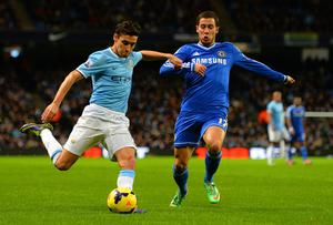 Jesus Navas of Manchester City is closed down by Eden Hazard of Chelsea