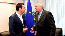 Greek Prime Minister Alexis Tsipras, left, and European Commission President Jean-Claude Juncker participate in a bilateral meeting on the sidelines of the EU-CELAC summit in Brussels. Photo: AP