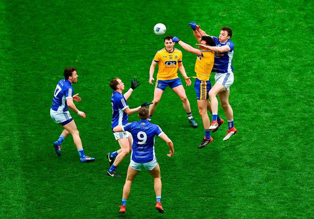 Roscommon's Tadhg O'Rourke and Gearóid McKiernan of Cavan battle in the air for possession. Photo: Daire Brennan/Sportsfile