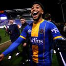Shrewsbury Town's Josh Laurent at full time as fans invade the pitch after the FA Cup fourth round match against Liverpool. Nick Potts/PA Wire.