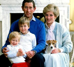 Prince Charles and Princess Diana pose for a family portrait with their children in 1986