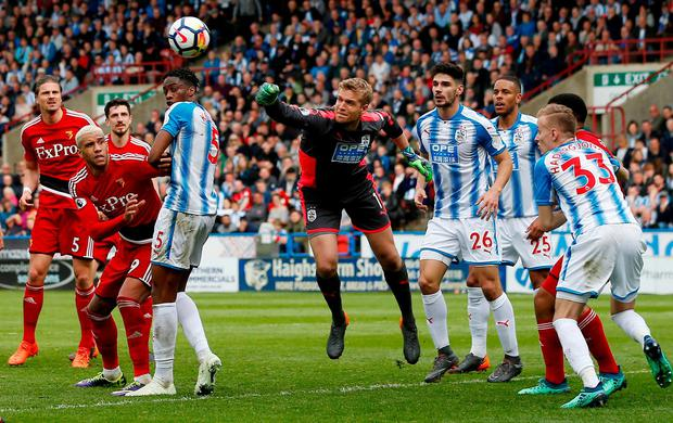 Huddersfield Town's Jonas Lossl punches the ball clear. Photo: Craig Brough/Action Images via Reuters