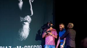UFC featherweight champion Conor McGregor is held back