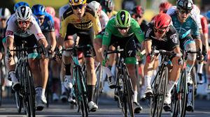 Australia's Caleb Ewan, right, goes to wheel to wheel with Ireland's Sam Bennett as he wins the race to the finish line on stage 11 of the Tour de France. (Christophe Petit-Tesson/Pool via AP)