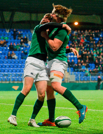 James McCarthy of Ireland celebrates scoring his side's fourth try with team-mate Sean Masterson. Photo: Sportsfile