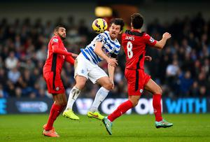 Queens Park Rangers' midfielder Joey Barton battles for an aerial ball with Leicester City's Matthew James during their Premier League clash at Loftus Road. Photo: Christopher Lee/Getty Images