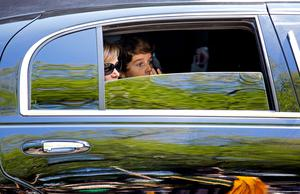 Melissa Rivers and her son Cooper Endicott look out the window of a car as they leave the funeral service for comedian Joan Rivers at Temple Emanu-El in New York Sunday, Sept. 7, 2014. Rivers died Thursday at 81. (AP Photo/Craig Ruttle)