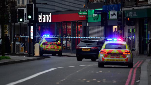 Police vehicles at the scene in Streatham High Road, south London after a man was shot dead by armed officers, with police declaring the incident as terrorist-related.: Kirsty O'Connor/PA Wire