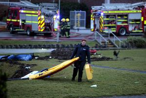 Gardi from Salthill helping fire crews to clear the damage in Salthill Park, Galway. Picture: Hany Marzouk
