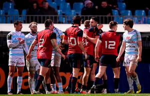 Andrew Conway, 14, is congratulated by his Munster team-mates, including Conor Murray, after scoring his side's third try during the European Rugby Champions Cup Pool 1 Round 1 match between Racing 92 and Munster at the Stade Yves-Du-Manoir in Paris, France. Photo by Stephen McCarthy/Sportsfile