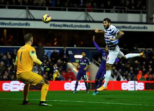 Queens Park Rangers' Charlie Austin (R) scores a goal past Manchester City's Joe Hart only to have the goal disallowed during their English Premier League soccer match at Loftus Road in London November 8, 2014.    REUTERS/Dylan Martinez (BRITAIN  - Tags: SPORT SOCCER) FOR EDITORIAL USE ONLY. NOT FOR SALE FOR MARKETING OR ADVERTISING CAMPAIGNS. EDITORIAL USE ONLY. NO USE WITH UNAUTHORIZED AUDIO, VIDEO, DATA, FIXTURE LISTS, CLUB/LEAGUE LOGOS OR 'LIVE' SERVICES. ONLINE IN-MATCH USE LIMITED TO 45 IMAGES, NO VIDEO EMULATION. NO USE IN BETTING, GAMES OR SINGLE CLUB/LEAGUE/PLAYER PUBLICATIONS.