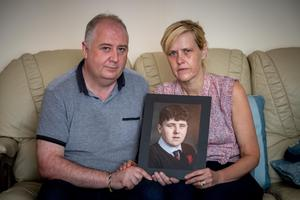LOSS: Johnny and Elaine Downey with a photograph of their son Jack who died in August after taking ecstasy/MDMA. Picture: Dylan Vaughan