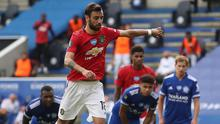 With his customary leap before striking, Bruno Fernandes scores a penalty for Manchester United against Leicester. Photo: Reuters