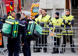 French firefighters gather outside the gymnasium where relatives and officials are due to pay tribute to the victims of the Airbus A320 crash, in Seyne-les-Alpes, March 25, 2015. REUTERS/Eric Gaillard