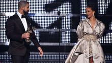 Drake presents the Video Vanguard award to Rihanna onstage during the 2016 MTV Music Video Awards at Madison Square Gareden on August 28, 2016 in New York City.  (Photo by John Shearer/Getty Images for MTV.com)