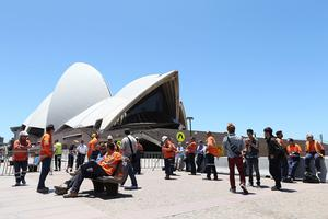 Construction workers gather in front of the Sydney Opera House after being evacuated. Photo: Joosep Martinson/Getty Images