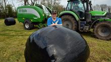 First cut: Damien McGrath takes a break over a silage bail. Contractors Willie and Barry Cunningham worked on the first cut at Damien's farm near Togher, County Galway. Photo: Ray Ryan