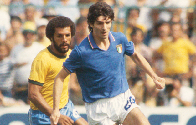 The late Paolo Rossi of Italy shields the ball from Junior of Brazil during the 1982 World Cup. Photo: Getty Images