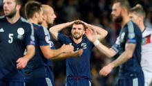Scotland's James Morrison (centre) looks dejected at the end of the UEFA European Championship Qualifying match at Hampden Park, Glasgow.