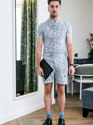 Rob Keary wears shirt and shorts, Nique; socks, COS; shoes, Hudson London; diary planner, Louis Vuitton. Picture: Kyran O'Brien