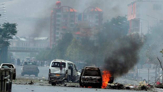 Fire and smokes rise at the site of a suicide attack during clashes with Taliban fighters in front of the Parliament, in Kabul, Afghanistan (AP Photo/Massoud Hossaini)