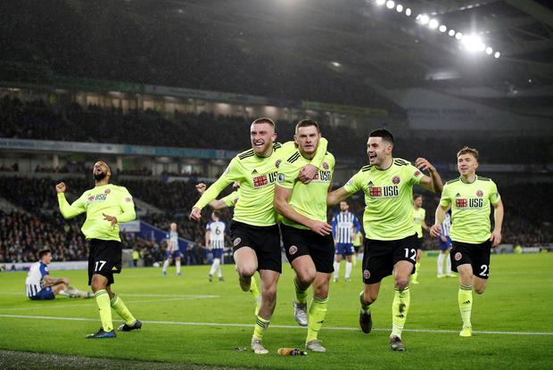 Sheffield United's Jack O'Connell celebrates scoring a goal with Oliver McBurnie and teammates before it is disallowed following a referral to VAR. Photo: David Klein/Reuters