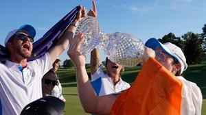 Europe's Leona Maguire drinks from the cup after their team defeated the United States at the Solheim Cup golf tournament, Monday, Sept. 6, 2021, in Toledo, Ohio. (AP Photo/Carlos Osorio)