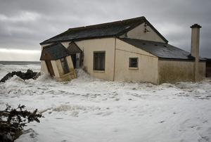 A damaged holiday home at Porters rocks near Arklow. Picture: Garry O'Neill