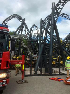 Handout photo taken with permission from the Twitter feed of @OFFICIALWMAS of the scene at Alton Towers as four teenagers have suffered serious leg injuries in a collision between two carriages on the amusement park's Smiler rollercoaster. West Midlands Ambulance Service/PA Wire