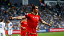 Wales' Gareth Bale celebrates scoring a goal against Israel during their Euro 2016 Group B qualifying soccer match at the Sammy Ofer Stadium in Haifa
