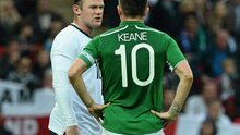 Robbie Keane, Republic of Ireland, in conversation with Wayne Rooney, England, during the 2013 international friendly at Wembley Stadium.