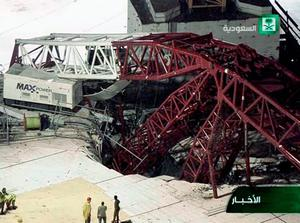 In this still image taken from video released by Saudi TV, a crane is seen collapsed over the Grand Mosque in Mecca, killing dozens, Friday, Sept. 11, 2015. The accident happened as pilgrims from around the world converged on the city, Islam's holiest site, for the annual Hajj pilgrimage, which takes place this month. (Saudi TV via AP)